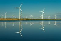 Windmills turbines with water reflection