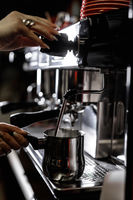 Close-up of professional coffee machine. Pouring espresso. Barista preparing deliciouse fresh hot coffee