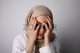 Portrait of young happy muslim woman passing stressful moment.