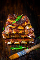 Hot spare ribs with herbs and spicies on black wooden background