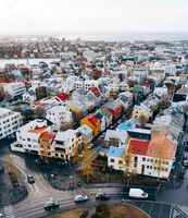 Reykjavik, Iceland - 02 may 2019: Reykjavik aerial view, downtown colored houses contrast with colors in the sky, the sea and mountain in the background
