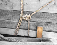 ropes knoted on wood