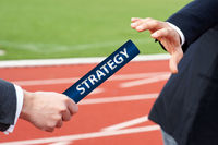 Businessmen pass strategy baton in rely race in stadium consulting concept