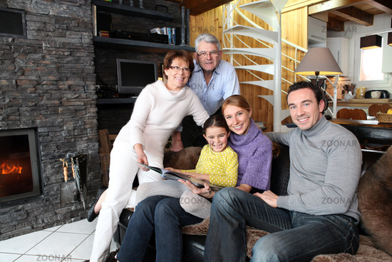 Family sitting in front of a fire
