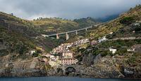 City of Riomaggiore at the edge of a rocky cliff, Cinque Terre Liguria, Italy