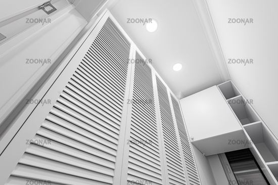 White laundry space inside wardobe room in new apartment
