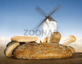 Different breads and windmill in the background