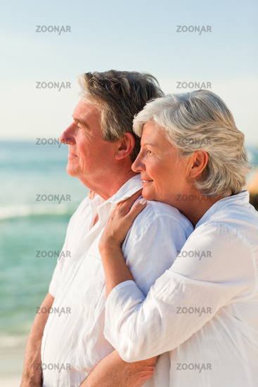 Woman hugging her husband at the beach