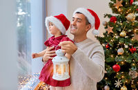 father and baby daughter on christmas at home