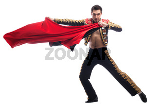 Handsome toreador in black costume with red cloth