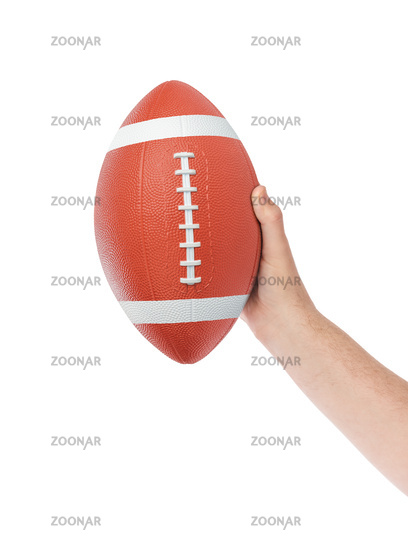 Hand and rugby ball