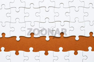 Set of white puzzle pieces and red blank copy space