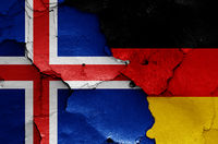 flags of Iceland and Germany painted on cracked wall