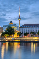 The river Spree in downtown Berlin with the famous TV Tower before sunrise