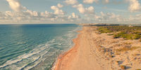 Aerial drone point of view sandy beach of La Mata. Spain