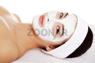 Beautiful woman with clay facial mask