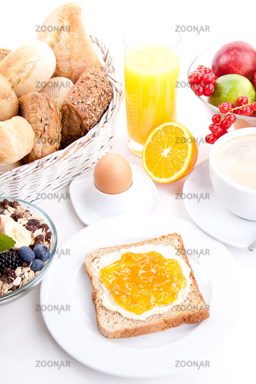 fresh breakfast with toast, jam, juice and egg isolated on white
