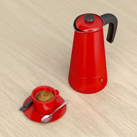 Moka pot and a cup of hot coffee