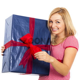 Young beautiful happy woman with big gift