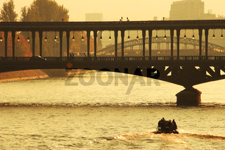 Bridge over the Seine river at sunset. Paris, France.