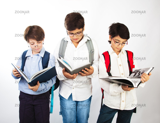 Three smart boys read books