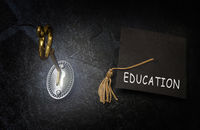 Gold education key and graduation cap