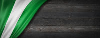 Nigerian flag on black wood wall banner