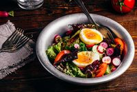 Fresh spring salad with homegrown vegetables and boiled eggs