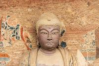 buddhist statue closeup in maiji mountain grottoes