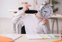 Male pupil in time management concept