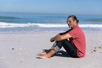 Senior Caucasian man enjoying time on the beach