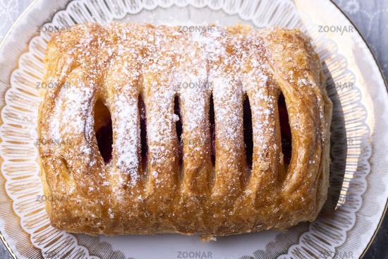 Cherry pastry with icing sugar
