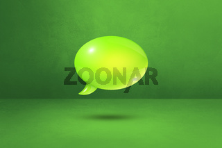 Green speech bubble on concrete wall background