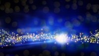 Magical blue Christmas background with bright stars and blurred lights