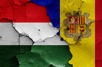 flags of Hungary and Andorra painted on cracked wall