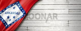 Arkansas flag on white wood wall banner, USA