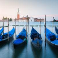 Venice lagoon. Gondolas moored by Saint Mark square with San Giorgio Maggiore