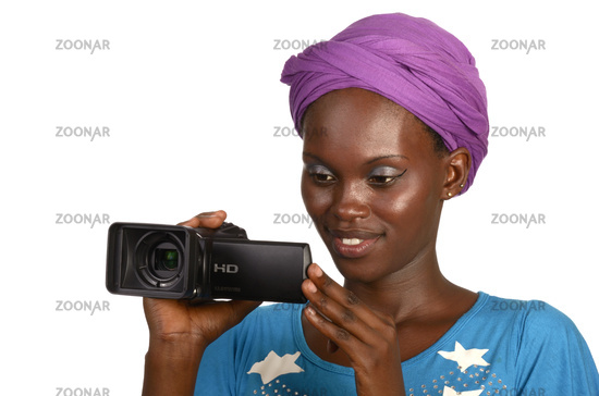 Pretty african woman with digital video camera