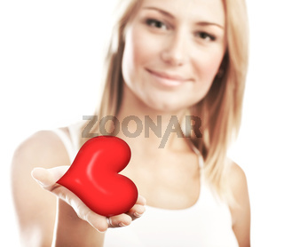 Beautiful woman holding heart, selective focus