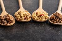 Various breakfast cereals. Morning granola in wooden scoop.