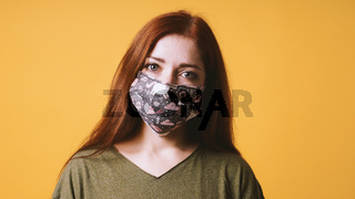 young woman wearing self-made everyday cloth face mask or community mask
