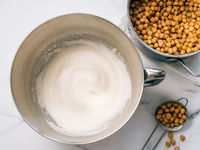 Whipped chickpea aquafaba in planetary mixer bowl