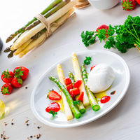 Burrata cheese with asparagus and strawberries