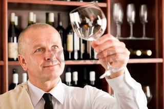 Wine bar waiter clean glass looking at