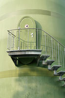 Stairs to a door on the tower of a wind turbine in an industrial area in Magdeburg in Germany