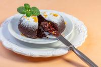 Chocolate cake with cocoa powder and orange peel.