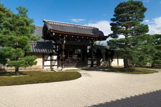 Sunlit stone zen garden with raked gravel an gate at Sogenchi garden at Tenryu-ji temple in Kyoto, Japan