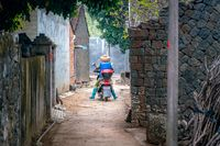 The rural street view of old traditional fisherman village on Hainan in China