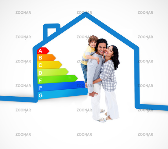 Smiling family standing with a blue house illustration with energy rating