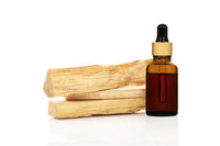Chandan or sandalwood piece with essential oil isolated on white background.